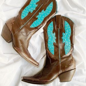Brown Cowboy boots with green armaments.